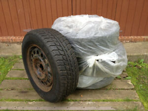 Four  P205 65 R15 winter tires on steel rims + wheelcovers