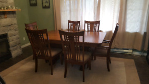 Large hardwood table with 6 chairs