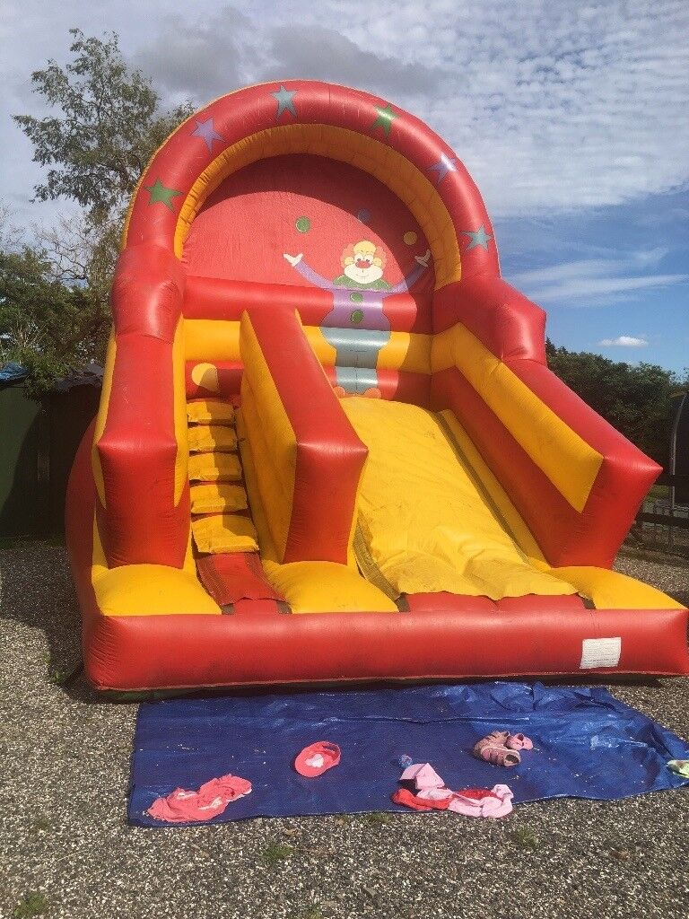 Industrial bouncy castle with slide