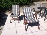 Two wooden garden chairs with removable cushions