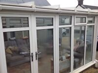 White pvc conservatory, 3 sided U shaped. Frames and roof reinforced with box section steel.