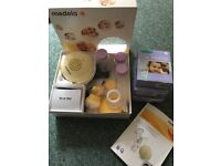 Medela swing breast pump, some parts never used