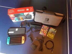 AS GOOD AS NEW BOXED NINTENDO SWITCH WITH NEON RED/BLUE JOYSTICKS