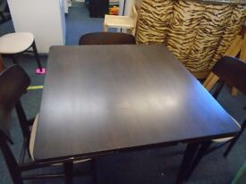 dark wood pull leaf table and 4 chairs.