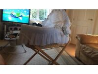 Moses basket with stand, mattress, trim, quilt, hood and several fitted sheets