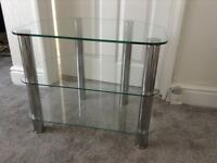 Glass TV stand,with chrome legs.