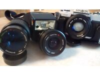Minolta X300 camera with 50mm lens &flash. Also tokina wide angle lens and tokina 200mm zoom lens.8