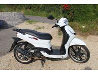 White Peugeot Tweet RS 125cc
