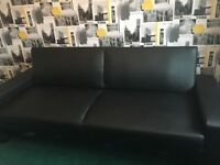 "Black ""Faux"" leather sofa bed and cushions"