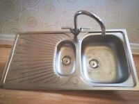 Sink with tap and fittings