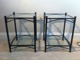 2 x Black metal frame side tables with 2 tempered glass shelves. Good condition.