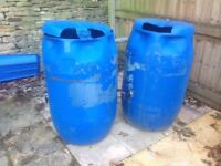 2 x blue plastic water barrels/butts