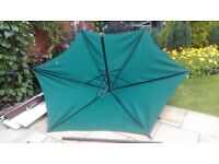 Green parasol, very large 2 metre x 2 mitre with wind open and close handle, metal pole - good cond