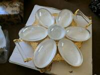 Round 24 carat gold plated. 7 divided glass partitioned serving dishes.