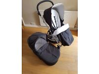 Mamas and papas sola travel system in black with carry cot, 2x rain covers, footmuff and parasol
