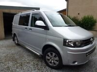 VW T5 kombi 2.0TDI 5 speed ready for camping rock and roll bed, storage units.