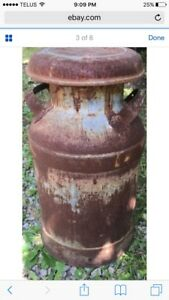 I AM LOOKING FOR (not selling) old milk cans / jugs
