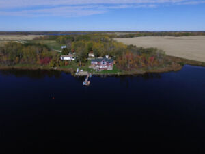 Private Lake property with guest home-46 acres or 1/4 available