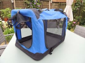 Leightweight Folding Dog Crate. Blue/black with carrying handles. In very good as new condition.