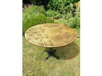 New, rustic out door table, cast iron legs, wood brass top.
