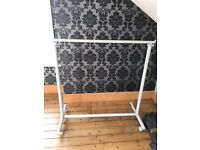 Powdered metal adjustable clothes rail