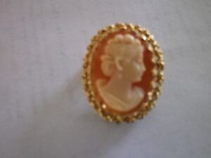 **Beautiful Oval Cameo** surrounded by intricate 14K gold....
