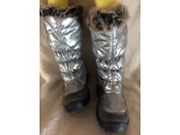 Brand new Moon boots size 6
