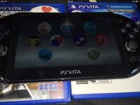 Ps vita with 8gb memory-card and 5 games and soft case
