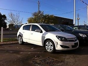 Saturn Astra XR hatchback, toitpano, cuire, A/C (semblable GOLF)