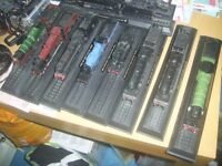 10 model trains on black plinths all excellent condition sell as one job lot