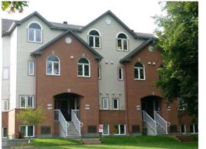 $1500  - 2 Bedrooms +Den Townhome in Manor Park - August 1.