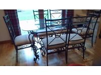 Dining table wrought iron/glass with 6 matching chairs