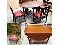 Barley twist table with drop sides and 4 chairs in good condition