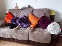 Very comfy brown three seater sofa reclines both ends, fab condition