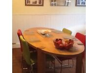 Large oval wooden table - modern style. Chairs also