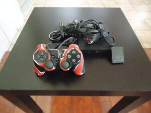 Console PS2 Slim + 10 jeux à vendre .. Négo