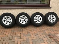 Toyota hilux alloy wheels and general grabber at2 tyres