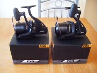 2 fox fx9 reels boxed for sale or swap for 2 daiwa ss2600 reels