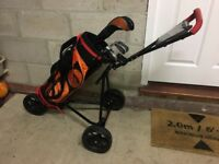 Junior golfs clubs with bag and trolley