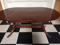 Dark wood mahogany dining room table extends to 7 foot