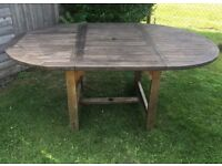 Wood Garden Table 6+. Old but still plenty of life. Can become a small round table.