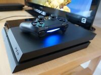 Playstation 4 with controller and a few games