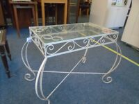 folded iron and glass coffee table.
