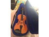Violin in box.