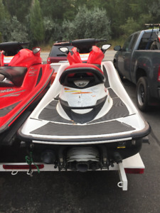Two Personal Watercraft and Trailer