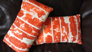 Red and orange throw pillows