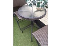 patio set brown solid rattan with thick glass top good condition. good quality £35.00