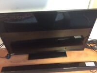Good condition 32 inch hd free view tv with logik soundbar