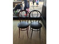 22 Cafe Chairs. Bistro style, mixture of black and red metal frames