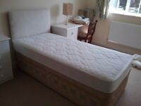 Single bed with sprung mattress